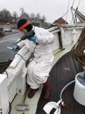 Bodil is removing the old paint