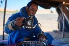 "Our host, Yaishi, serving ""beduin vodka"""
