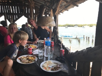 Lunch at the Lamin Lodge with the anchored boats in the background